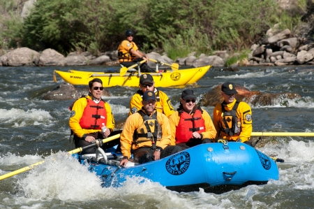 CANON CITY, COUSA - MAY 19, 2012: Colorado State Exec. Dir.n of the Dept. of Natural Resources Mike King (rear left) rafts the site of the Jea ClaudeCristo Over The River project.