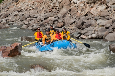 CANON CITY, CO/USA - MAY 19, 2012: Colorado State Exec. Dir.n of the Dept. of Natural Resources Mike King (rear left) rafts the site of the Jea Claude/Cristo Over The River project. 報道画像
