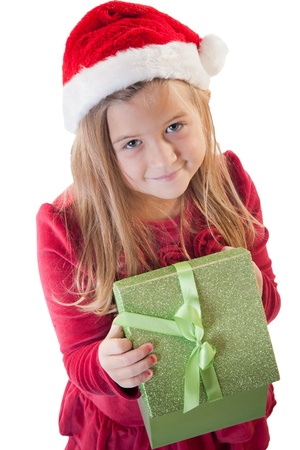 white isolation of young girl wearing santa hat holding present smiling at viewer
