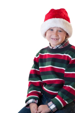 White isolation young boy wearing santa hat smiling 写真素材