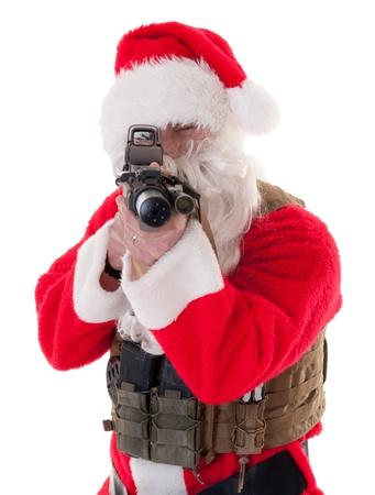 saint nick: Santa pointing AR15 directly at camera - white isolation