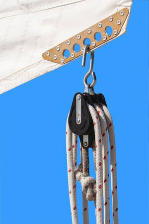 Rigging on a modern sailing yacht isolated on blue background