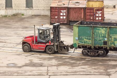 Scene from the daily life of the cargo terminal. A loader is used as a tractor for moving pastures 스톡 콘텐츠