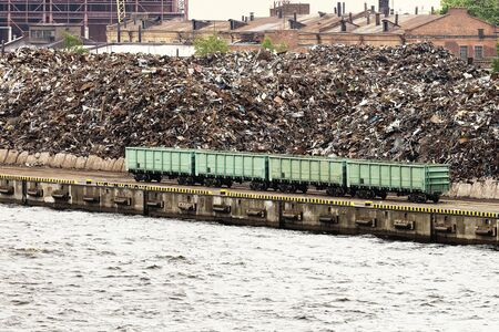 A huge amount of scrap metal accumulates in the cargo port. Metal is brought in wagons, then scrap metal is loaded onto ships