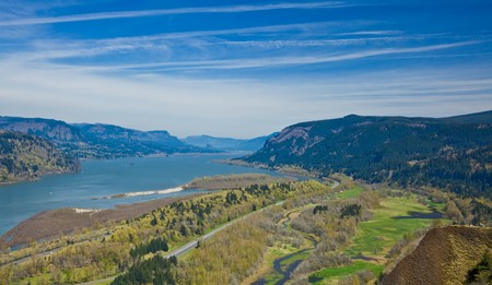 River Gorge.  Columbia River Gorge National Scenic Area.  Scenic view of Columbia River Gorge receding under blue sky and cloudscape.    photo