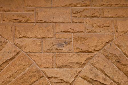 nonuniform: Stone wall of natural stones .  Fragment of a Stone wall of natural stones  Stock Photo