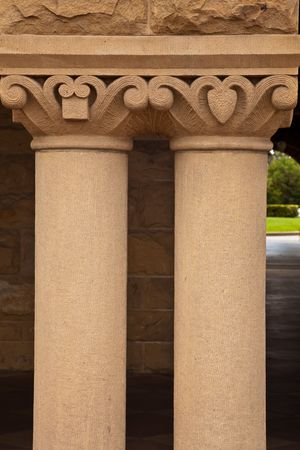 Building Pillars.  A photograph depicts closeup of two building pillars. photo