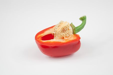 half cut: Half cut  red pepper isolated on white Stock Photo