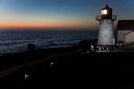 Lighthouse after sunset. Point Montara Lighthouse, Pacific Ocean, California, U.S.A. photo
