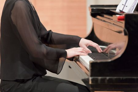 conservatory: Hands of piano player Stock Photo