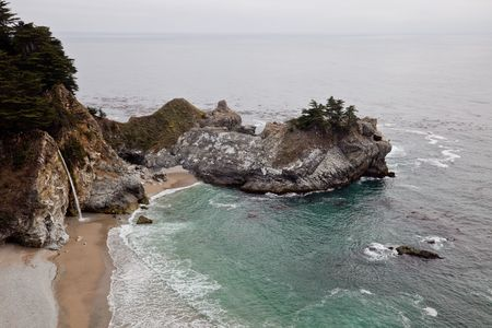 mcway: McWay Falls is an 80 foot waterfall located in Julia Pfeiffer Burns State Park  that flows year-round. Like Alamere Falls, this waterfall is one of only two in the region that are close enough to the ocean to be referred as  Stock Photo