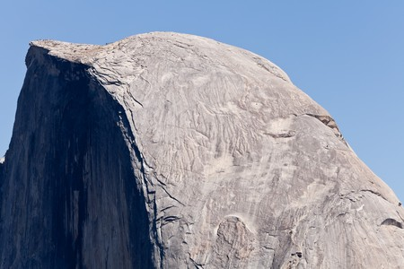 Half Dome is a granite dome in Yosemite National Park, California, U.S.A.  The granite crest rises more than 4,737 ft (1,444 m) above the valley floor. photo