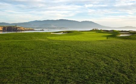 Golf course with sand traps landscape.  photo