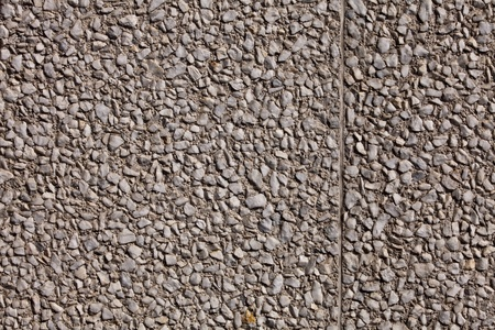 Fragment of a crushed granite wall background.