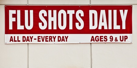Flu shots sign posted outside. Stok Fotoğraf