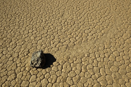 Background: Revealed bottom of  Racetrack Playa, Death Valley National Park, California. The Racetrack Playa, or The Racetrack, is a scenic dry lake. Stock Photo - 9737038