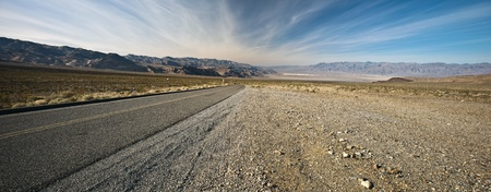 borax: Long road in Death Valley National Park, California. Death Valley is a desert valley located in Eastern California.