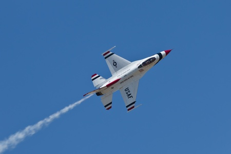 speed of sound: TRAVIS AIR FORCE BASE, CA - JULY 30: US Air Force Thunderbirds Demonstration Squadron, flying on Lockheed Martin F-16 Fighting Falcon showing precision of flying and the highest level of pilot skills during  Airshow  on July 30, 2011 at  Travis Air Force