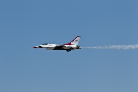 lockheed martin: TRAVIS AIR FORCE BASE, CA - JULY 30: US Air Force Thunderbirds Demonstration Squadron, flying on Lockheed Martin F-16 Fighting Falcon showing precision of flying and the highest level of pilot skills during  Airshow  on July 30, 2011 at  Travis Air Force