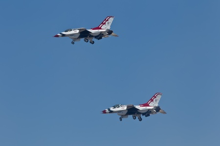 TRAVIS AIR FORCE BASE, CA - JULY 30: US Air Force Thunderbirds Demonstration Squadron, flying on Lockheed Martin F-16 Fighting Falcon showing precision of flying and the highest level of pilot skills during  Airshow  on July 30, 2011 at  Travis Air Force