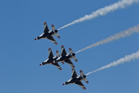 f 16: TRAVIS AIR FORCE BASE, CA - JULY 30: US Air Force Thunderbirds Demonstration Squadron, flying on Lockheed Martin F-16 Fighting Falcon showing precision of flying and the highest level of pilot skills during  Airshow  on July 30, 2011 at  Travis Air Force