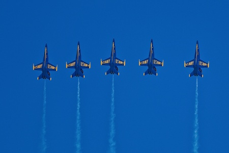 SAN FRANCISCO, CA - OCTOBER 6: US Navy Demonstration Squadron Blue Angels, flying on Boeing F/A-18 Hornet showing precision of flying and the highest level of pilot skills during Fleet Week on October 6, 2011 in San Francisco, CA.  Stock Photo - 11887550
