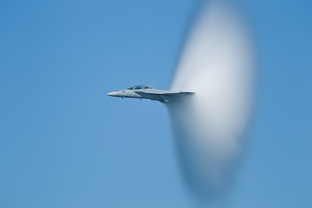 singularity: SAN FRANCISCO, CA - OCTOBER 8: VFA-122 Boeing FA-18F Super Hornet aircraft surrounded in vapor cone during 2011 Fleet Week on October 8, 2011 in San Francisco, CA.  Editorial