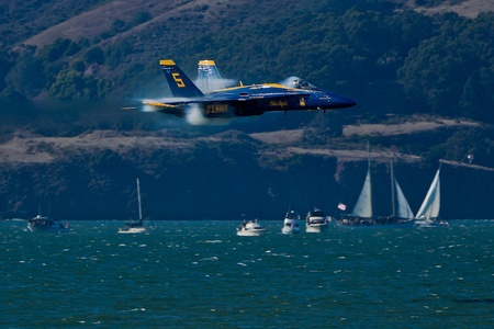 SAN FRANCISCO, CA - OCTOBER 8: US Navy Demonstration Squadron Blue Angels, flying on Boeing FA-18 Hornet showing precision of flying and the highest level of pilot skills during Fleet Week on October 8, 2011 in San Francisco, CA.