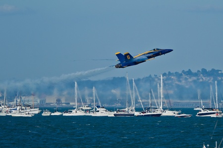SAN FRANCISCO, CA - OCTOBER 8: US Navy Demonstration Squadron Blue Angels, flying on Boeing F/A-18 Hornet showing precision of flying and the highest level of pilot skills during Fleet Week on October 8, 2011 in San Francisco, CA.  Stock Photo - 11887531