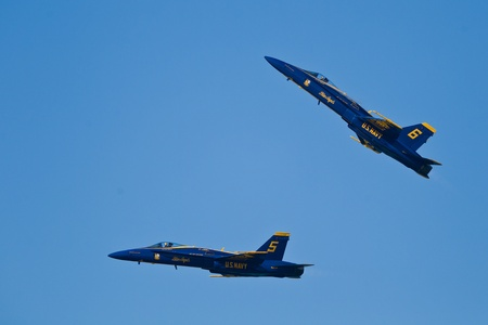 f 18: SAN FRANCISCO, CA - OCTOBER 8: US Navy Demonstration Squadron Blue Angels, flying on Boeing FA-18 Hornet showing precision of flying and the highest level of pilot skills during Fleet Week on October 8, 2011 in San Francisco, CA.