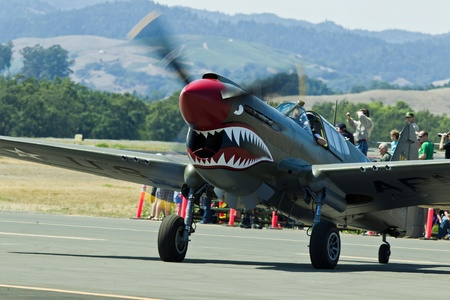 charles county: SANTA ROSA, CA - AUG 20: Curtiss P-40E Warhawk aircraft ready to taxi for takeoff during the Wings Over Wine Country Air Show, on August 20, 2011, Charles M. Schulz - Sonoma County Airport, Santa Rosa, CA.