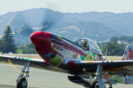 SANTA ROSA, CA - AUG 20: North American Aviation P-51D Mustang aircraft ready to taxi for takeoff during the Wings Over Wine Country Air Show, on August 20, 2011, Charles M. Schulz - Sonoma County Airport, Santa Rosa, CA.
