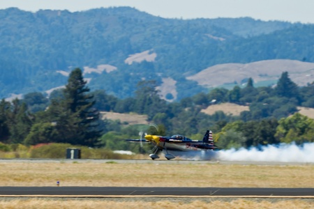 """charles county: SANTA ROSA, CA - AUG 21: Kirby Chambliss demonstrates  """"Cobra"""" takeoff during the Wings Over Wine Country Air Show, on August 21, 2011, Charles M. Schulz - Sonoma County Airport, Santa Rosa, CA. Editorial"""