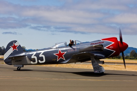 SANTA ROSA, CA - AUG 21: Pilot Will Whiteside taxi on his Yakovlev model 3U, or a YAK3UR2000 during the Wings Over Wine Country Air Show, on August 21, 2011, Charles M. Schulz - Sonoma County Airport, Santa Rosa, CA.