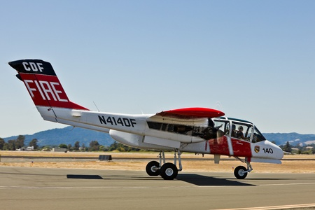 charles county: SANTA ROSA, CA - AUG 21: CDF pilot Patty Wagstaff taxi her North American OV-10A aircraft after arriving from patrol flight during the Wings Over Wine Country Air Show, on August 21, 2011, Charles M. Schulz - Sonoma County Airport, Santa Rosa, CA.         Editorial