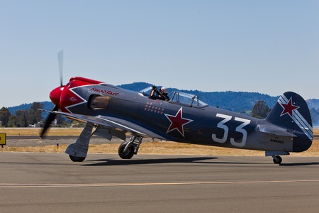 charles county: SANTA ROSA, CA - AUG 21: Pilot Will Whiteside taxi on his Yakovlev model 3U, or a YAK3UR2000 during the Wings Over Wine Country Air Show, on August 21, 2011, Charles M. Schulz - Sonoma County Airport, Santa Rosa, CA.