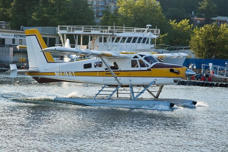 SEATTLE, WA - AUG 29: Kenmore Air1968 Dehavilland BEAVER DHC-2 MK.3 aircraft taxi at Lake Union Terminal, on August 29, 2011, Seattle, WA.