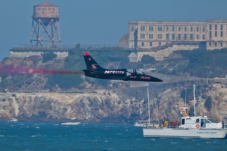 SAN FRANCISCO, CA - OCTOBER 8: Patriots Jet Team on L-39 Albatross aircrafts showing precision of flying, the highest level of pilot skills during Fleet Week on October 8, 2011 in San Francisco, CA.  Stock Photo - 12778450
