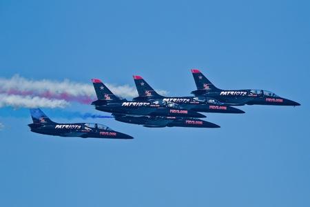 SAN FRANCISCO, CA - OCTOBER 8: Patriots Jet Team on L-39 Albatross aircrafts showing precision of flying, the highest level of pilot skills during Fleet Week on October 8, 2011 in San Francisco, CA.  Stock Photo - 12778453