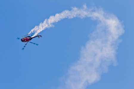 SALINAS, CA - SEPT 25: Pilot Chuck Aaron demonstrates precision of flying and the highest level of pilot skills on Red Bull aerobatic helicopter during the California International Airshow, on September 25, 2011, Salinas, CA. Stock Photo - 12878001