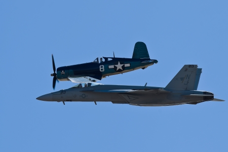 SALINAS, CA - SEPT 25: US NAVY Boeing FA-18 Super Hornet and Vought F4U Corsair during heritage flight at the California International Airshow, on September 25, 2011, Salinas, CA.