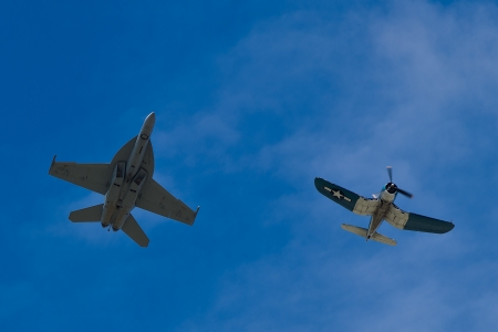 f 18: SALINAS, CA - SEPT 25: US NAVY Boeing FA-18 Super Hornet and Vought F4U Corsair during heritage flight at the California International Airshow, on September 25, 2011, Salinas, CA.