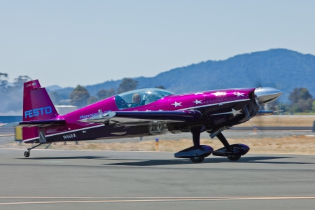 charles county: SANTA ROSA, CA - AUG 20: Vicky Benzing taxi in her purple Extra 300S after demonstration of high performance aerobatics during the Wings Over Wine Country Air Show, on August 20, 2011, Charles M. Schulz - Sonoma County Airport, Santa Rosa, CA. Editorial