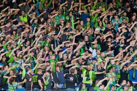 PORTLAND, OR - JUNE 24: Seattle Sounders supporters wave their armes in support of the team during Seattle Sounders vs. Portland Timbers game, on June 24, 2012 at Jeld-Wen Field in Portland, OR.