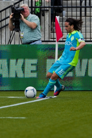 PORTLAND, OR - JUNE 24: Mauro Rosales #10 of the Seattle Sounders performs corner kick during Seattle Sounders vs. Portland Timbers game, on June 24, 2012 at Jeld-Wen Field in Portland, OR. Stock Photo - 14339607