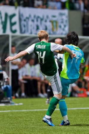 wen: PORTLAND, OR - JUNE 24: Fredy Montero #17 of the Seattle Sounders battles for a ball with Steven Smith #14 of the Portland Timbers during the game, on June 24, 2012 at Jeld-Wen Field in Portland, OR. Editorial