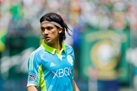 expects: PORTLAND, OR - JUNE 24: Forward Fredy Montero #17 of the Seattle Sounders expects a ball during Seattle Sounders vs. Portland Timbers game, on June 24, 2012 at Jeld-Wen Field in Portland, OR. Editorial