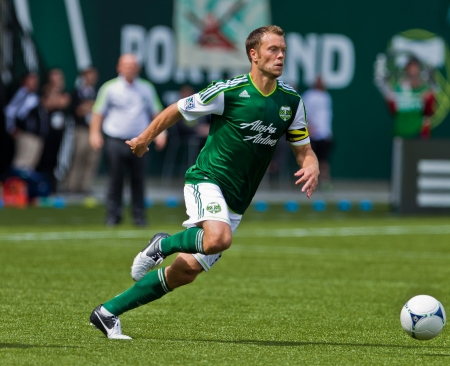 PORTLAND, OR - JUNE 24: Jack Jewsbury #13 of the Portland Timbers controls a ball during Seattle Sounders vs. Portland Timbers game, on June 24, 2012 at Jeld-Wen Field in Portland, OR.