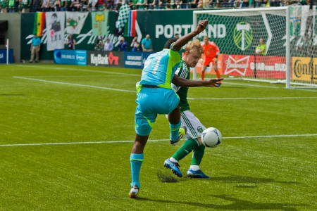 PORTLAND, OR - JUNE 24: Steven Smith #14 of the Portland Timbers battles for a ball with Cordell Cato #21of the Seattle Sounders during the game, on June 24, 2012 at Jeld-Wen Field in Portland, OR.