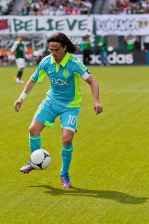 PORTLAND, OR - JUNE 24: Mauro Rosales #10 of the Seattle Sounders controls a ball during Seattle Sounders vs. Portland Timbers game, on June 24, 2012 at Jeld-Wen Field in Portland, OR. Stock Photo - 14339592